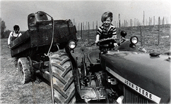 Son on tractor.
